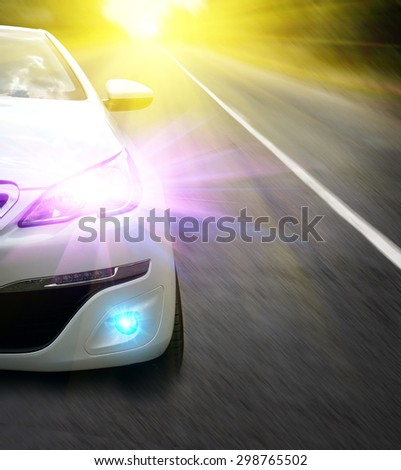 A car driving on a motorway at high speeds