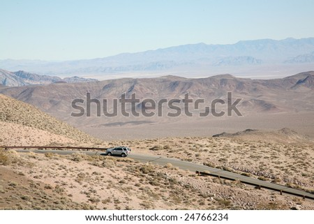 A car driving through Death Valley National Park. - stock photo