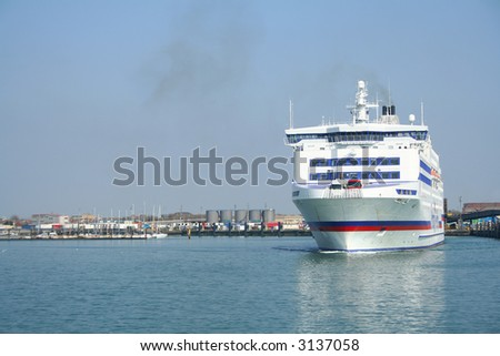 A car ferry leaves Portsmouth harbour for France - stock photo