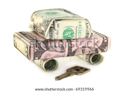a car from dollar bills in front of white background