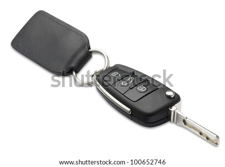 a car key and fob with shallow depth of field on white with clipping path - stock photo