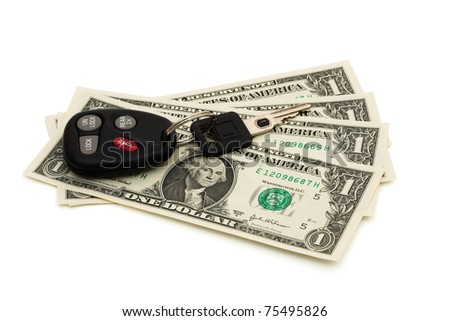 A car keychain and key with one dollar bills, Raising cost of gas - stock photo