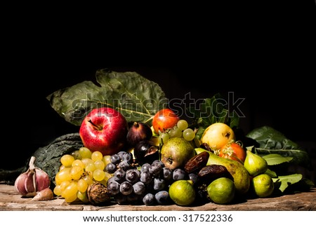 A Caravaggio's styled and lighted still life of fruits and vegetables. All the ingredients were available before 800ad in central europe. - stock photo