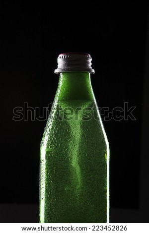 A carbonated soft drink Bottle with whirlpool(vortex) Isolated on black Background. - stock photo