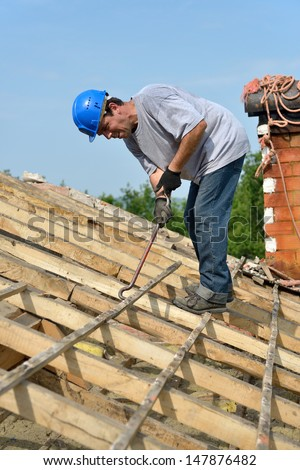 a carpenter roofer who renovated the roof - stock photo