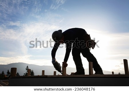 A carpenter working on a construction site