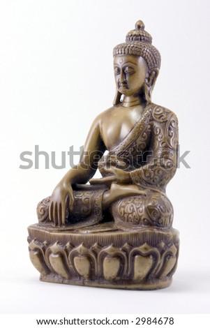 A carved Buddha figurine - stock photo