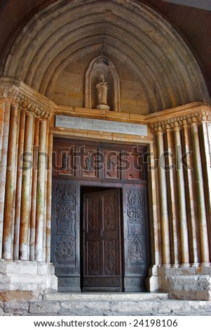 A carved door in ancient church to Provence
