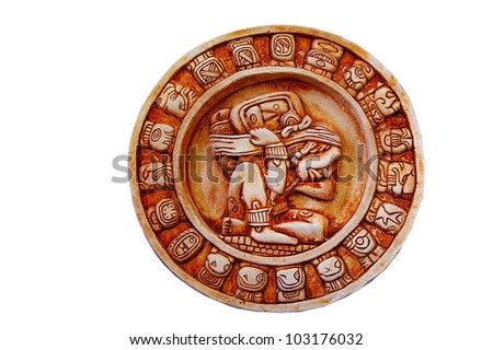 A carved Mayan calendar isolated on white - stock photo
