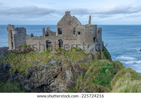 A castle on the coast of Northern Ireland - stock photo
