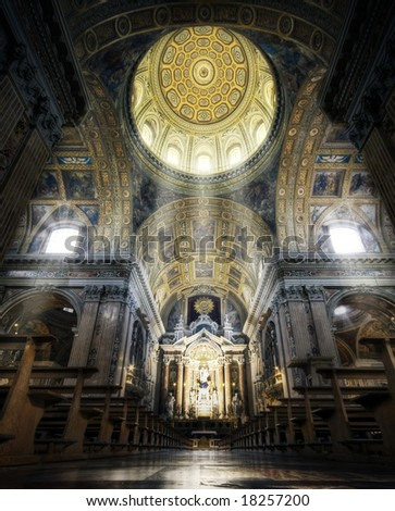 A cathedral interior with beams of light coming through the windows - stock photo