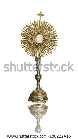 A Catholic priest santisimo host at Communion and face of Jesus - stock photo