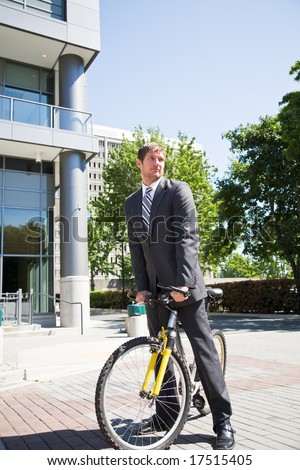 A caucasian businessman riding a bike to work - stock photo