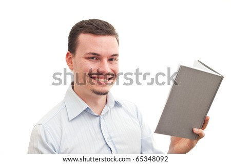 A caucasian male is reading a grey book isolated on a white background - stock photo