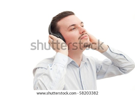 A caucasian male listens to music through headphones - stock photo