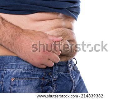 A caucasian man grabs his far hairy belly - stock photo