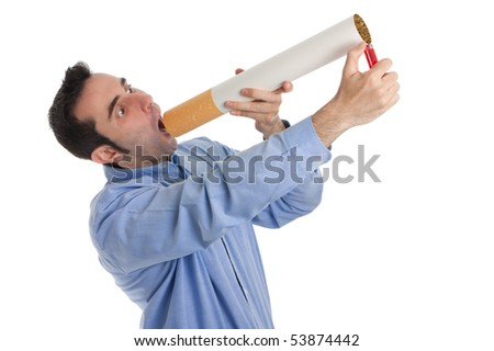 A caucasian man in his thirties, wearing a button down shirt, tries desperately to light a giant cigarette which he can hardly fit between his lips. - stock photo