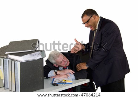a caucasian senior businessman being caught while sleeping during office hours by his angry boss, a mature African-American businessman, isolated on white background - stock photo