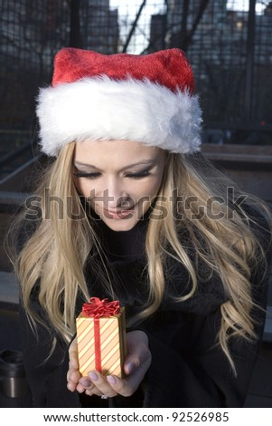 A Caucasian woman holding a Christmas holiday ornament.