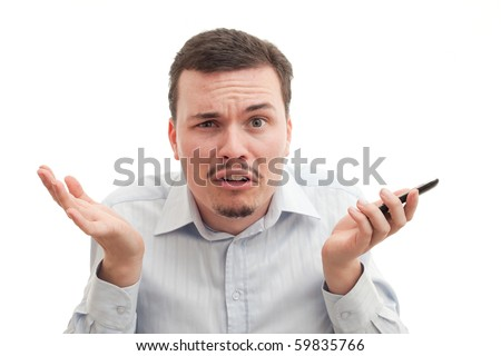 A causasian male puzzled by technology - stock photo