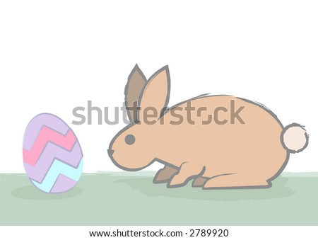 A cautious easter bunny checks out an easter egg by sniffing. - stock photo
