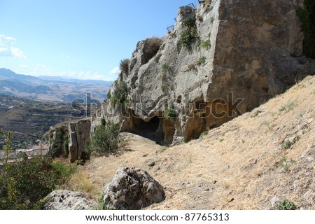 A cave in the rock wall of Loch Ard Gorge, National Park, sicily,italy - stock photo