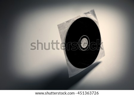 a CD , DVD disk with dark shadow ,  technology concept.