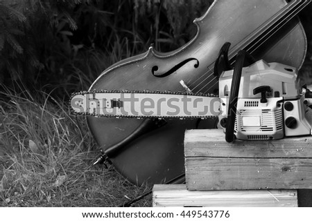 A cello next to a chainsaw, music background, in black and white