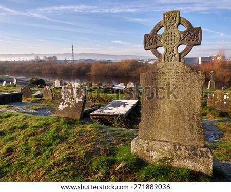 A Celtic cross on an old graveyard in Ireland - stock photo