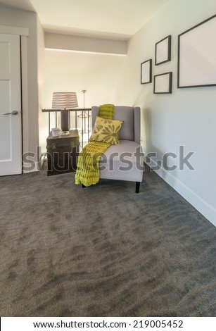 A chair and decorative thinks around in the corner of the room. Fragment. Interior design. Vertical. - stock photo