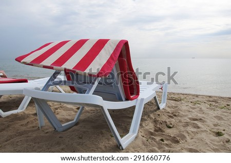 A chair for relaxing on the beach - stock photo