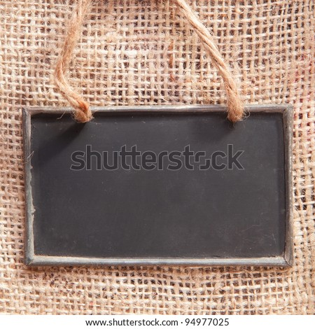 a chalkboard on a textile coffee bag - stock photo