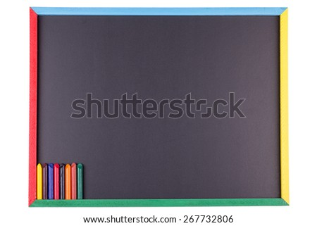 A Chalkboard with Colorful Crayons Isolated on a White Background.  - stock photo