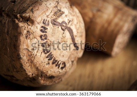 A Champaign cork in a moody setting. - stock photo