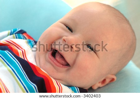 A charming portrait of a little baby boy.  He is 3 months old in this series. - stock photo