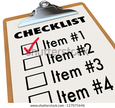 A checklist on a wood and metal clipboard with a check next to the first item, a list of things you have to do today - tasks, to-dos, chores or other items - stock photo