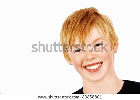 A cheerful and smiling young boy - stock photo