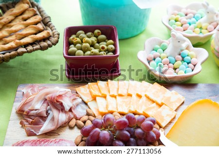 A cheerful array of Easter snacks on a party table - stock photo