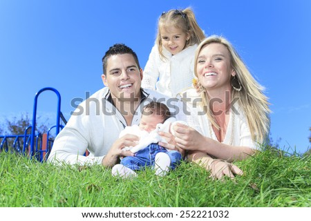 A Cheerful family with waterfall on the background - stock photo