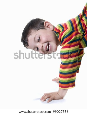 A cheerful kid smiling on white - stock photo