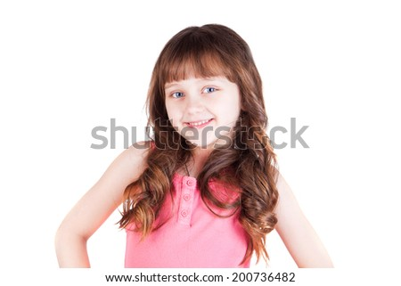 A cheerful little girl isolated on the white background