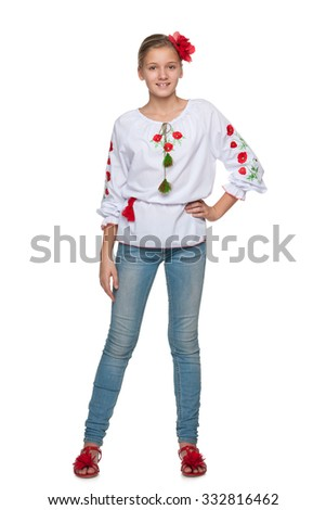 A cheerful teen Ukrainian girl against the white background - stock photo