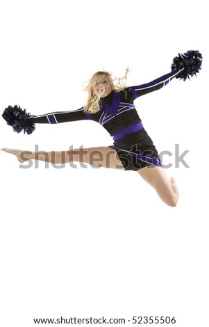 A cheerleader has jumped and is in the air with one leg out. - stock photo