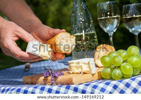 A chef preparing a delicious summer lunch - stock photo