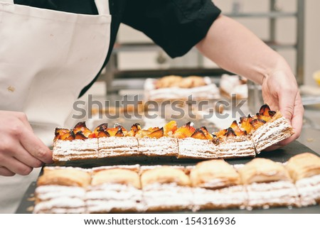 a chef preparing pastries - stock photo