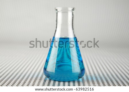 a chemist or medical research scientist adds chemicals to a erlenmeyer flask for a violent chemical reaction on a black and white background - stock photo