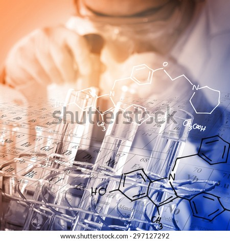 A Chemist working in the laboratory with periodic table and chemical equations background - stock photo
