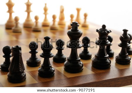 A chess board set up ready for a game - stock photo