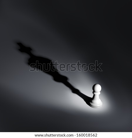 A chess pawn casting a king piece shadow - strength and aspirations concept