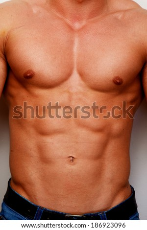 A chest of a tanned man - stock photo